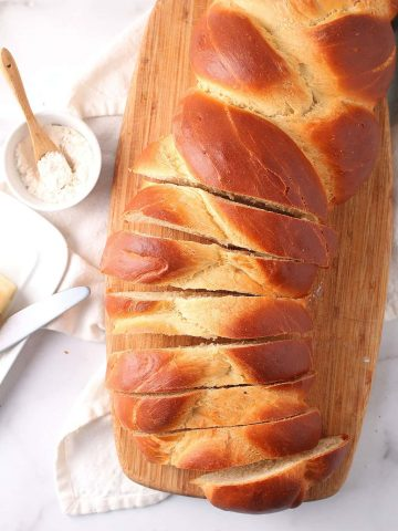 Loaf of vegan challah on cutting board