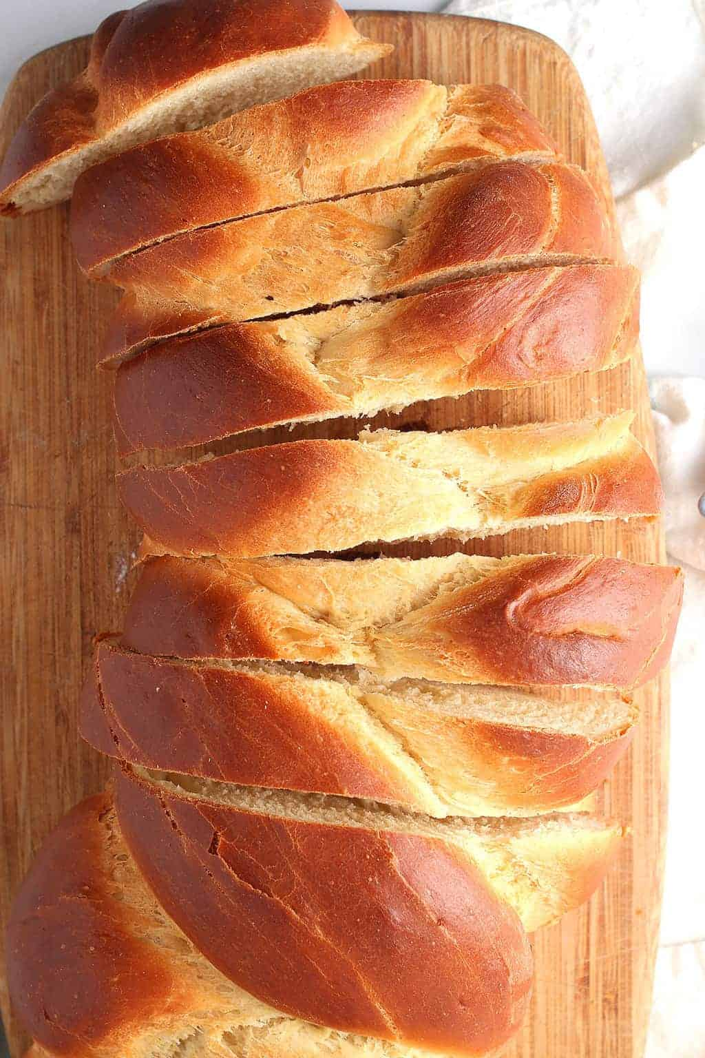 Slices of challah bread on cutting board