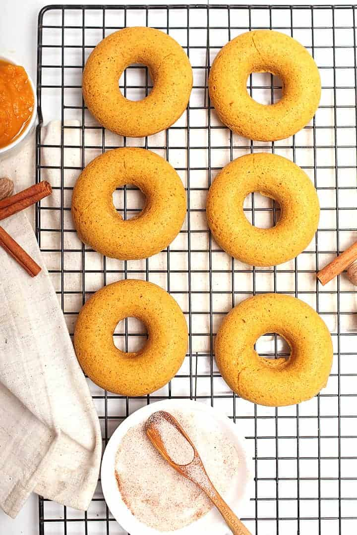 Vegan pumpkin donuts on cooling rack