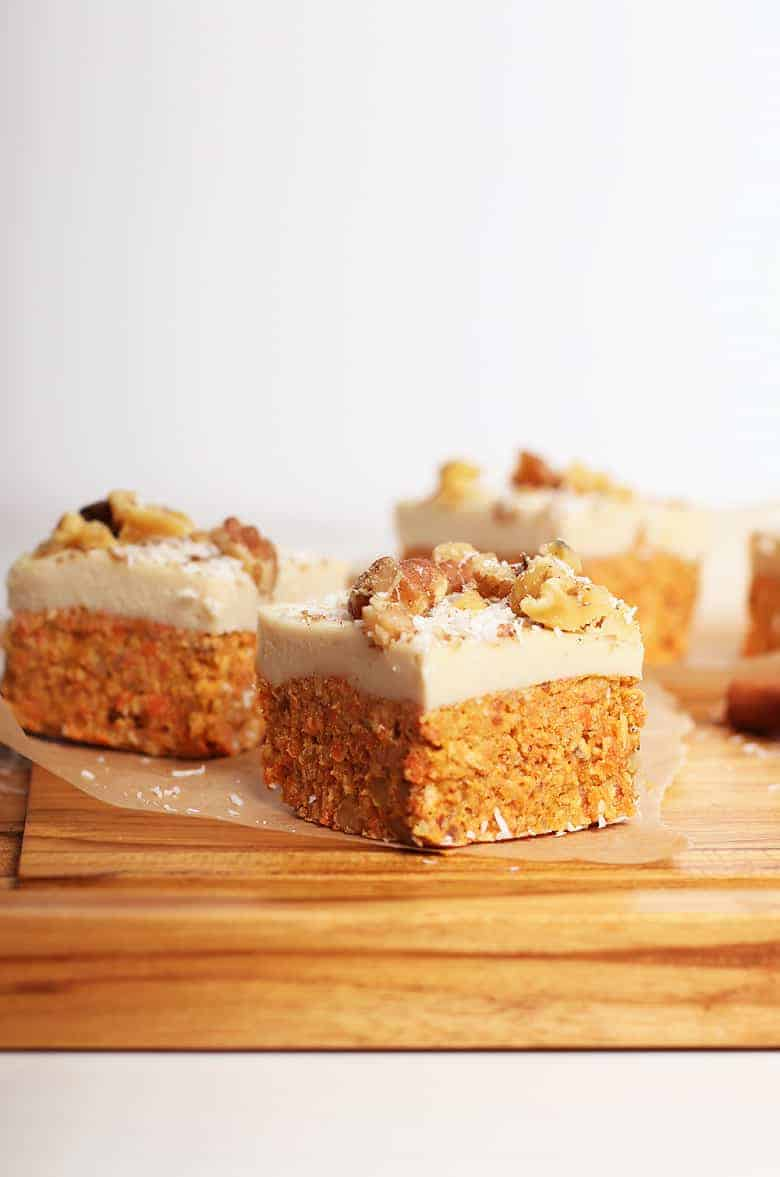 Raw carrot cake bites on a cutting board