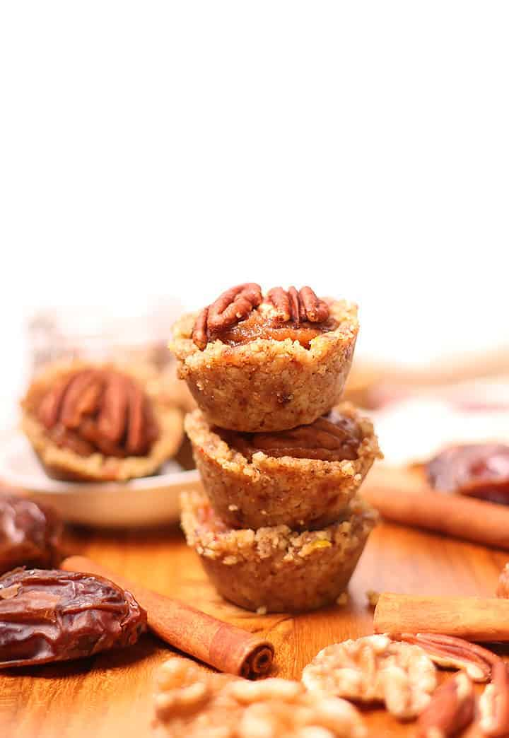 Stack of Raw pecan pie tartlets