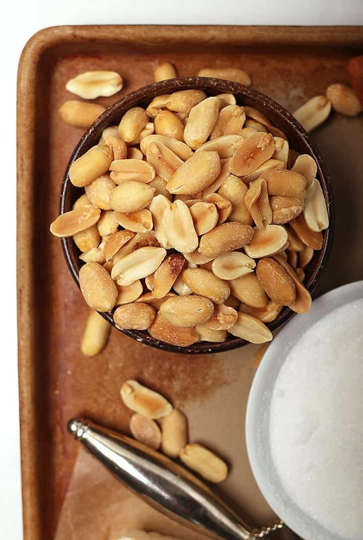 Bowl of peanuts and sugar