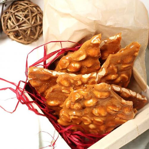 Homemade peanut brittle in a gift box