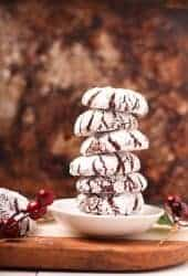 Stack of vegan chocolate crinkle cookies