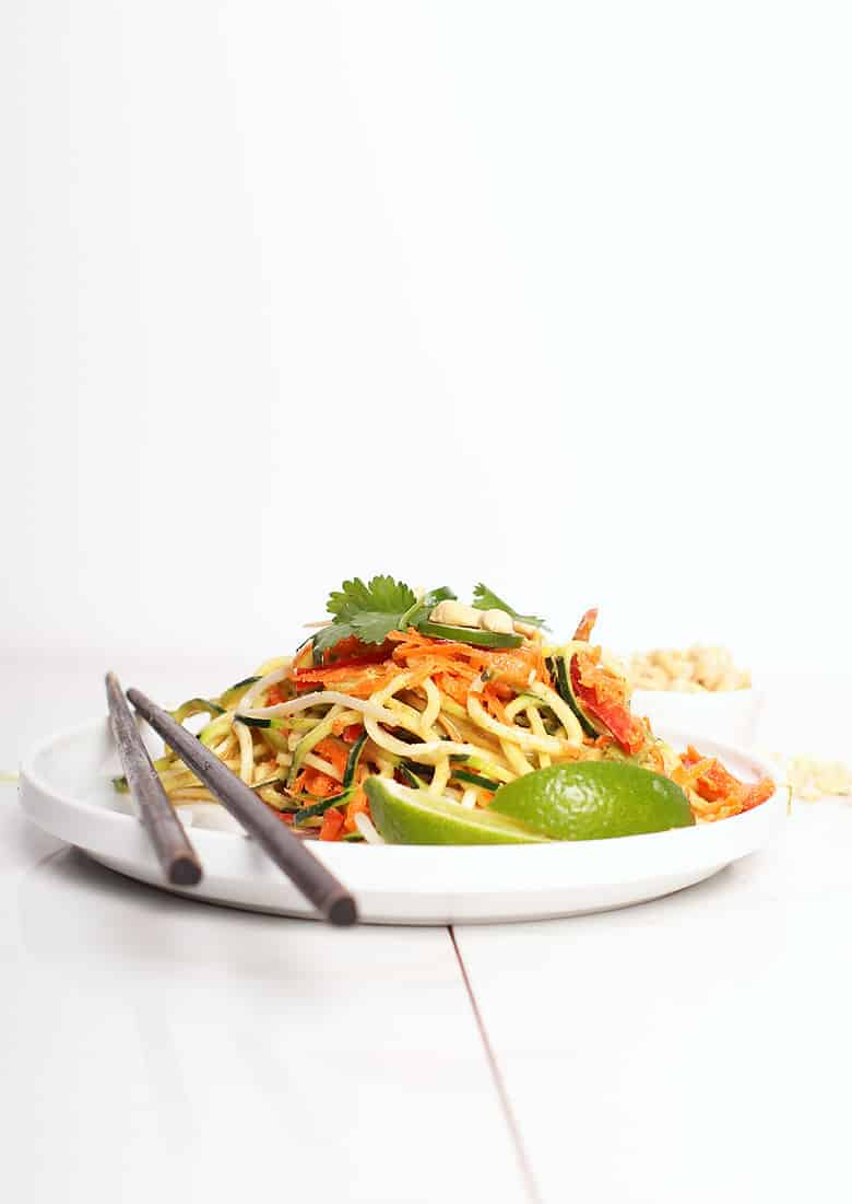 Raw Pad Thai on a white plate with chop sticks