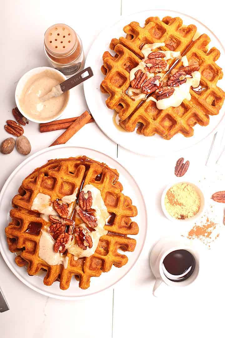 Vegan pumpkin waffles on two white plates