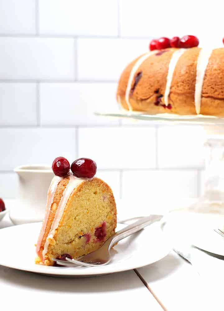 Slice of Cranberry Orange Pound Cake on white plate