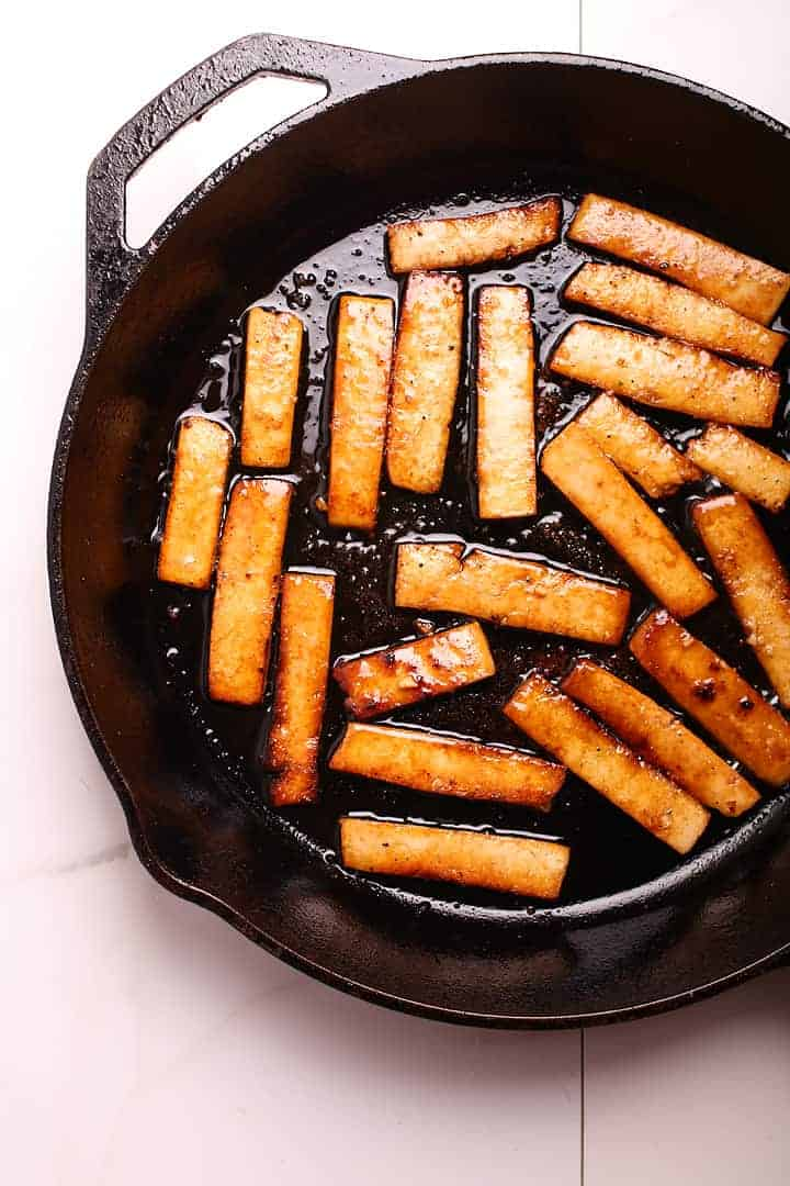 Sautéed tofu in a cast iron skillet