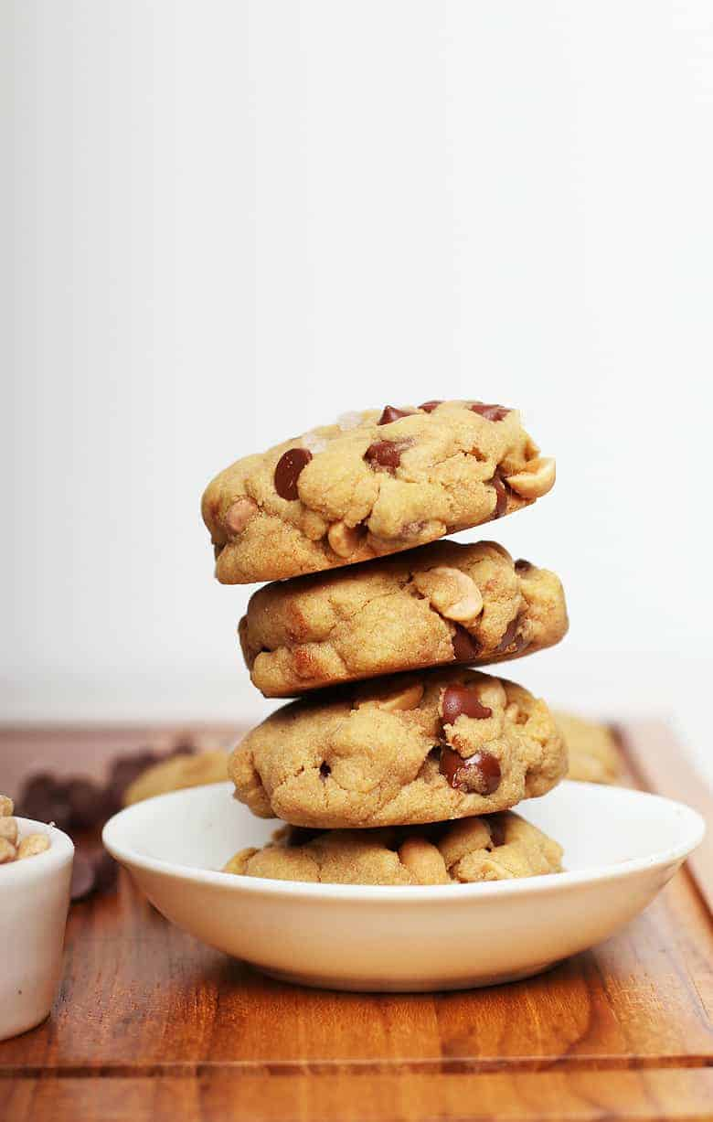 Stacked gluten free cookies in a white bowl