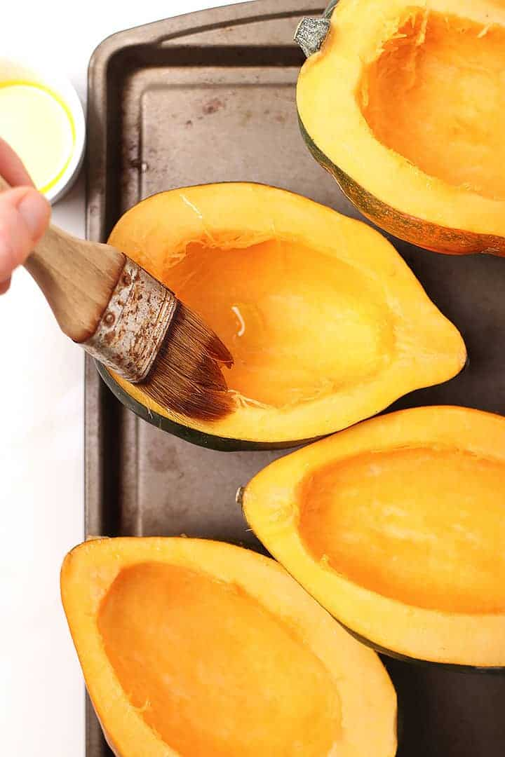 Acorn squash on baking sheet