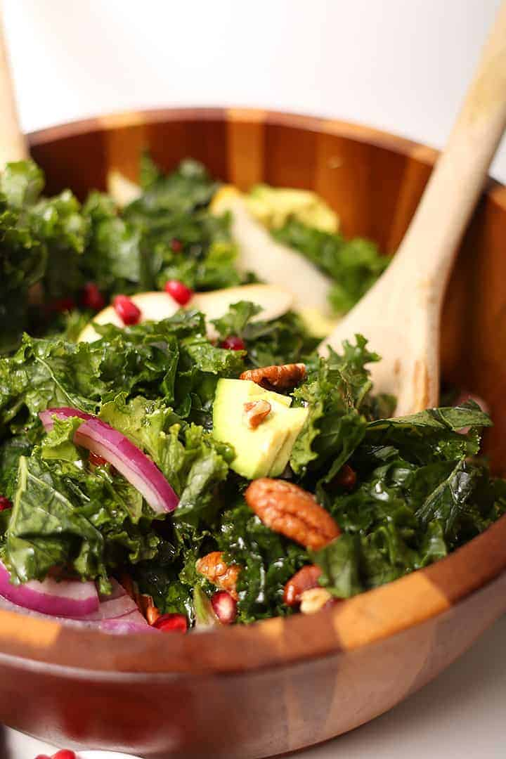 Winter Kale Salad in wooden salad bowl