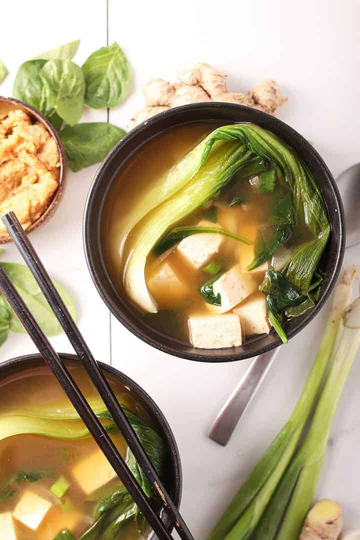 Two bowls of vegetable soup with tofu