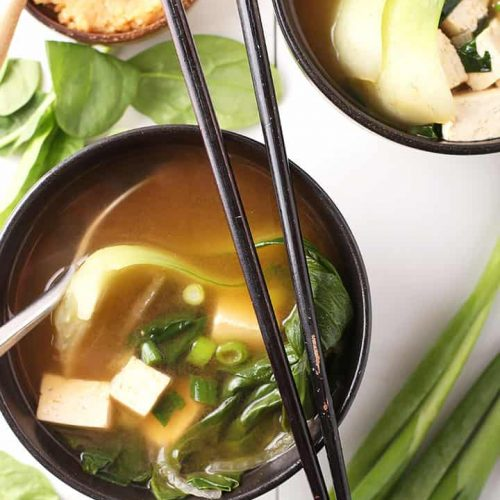Miso soup in a black bowl