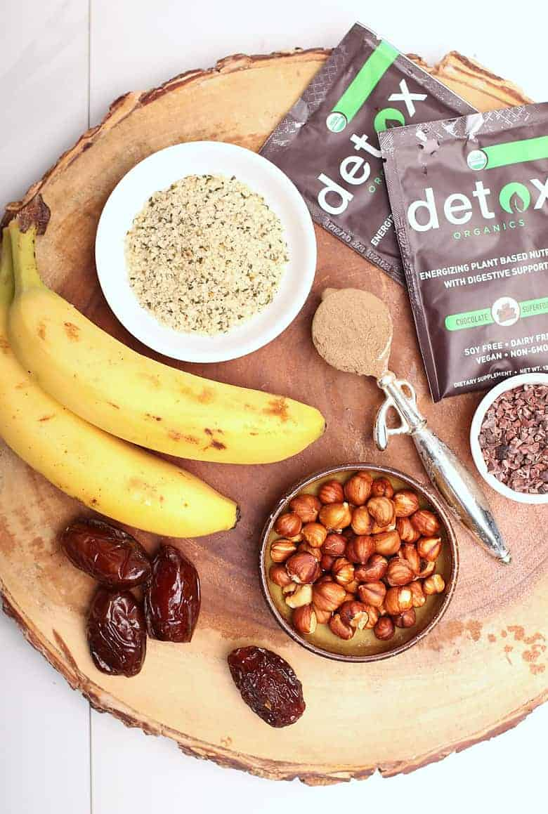 Hazelnuts, hemp, chocolate, and bananas on wooden board