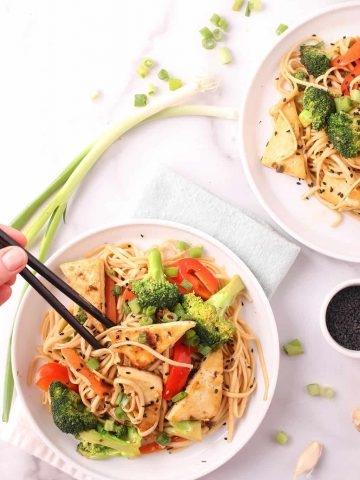 Udon Noodle Stir Fry on two white plates