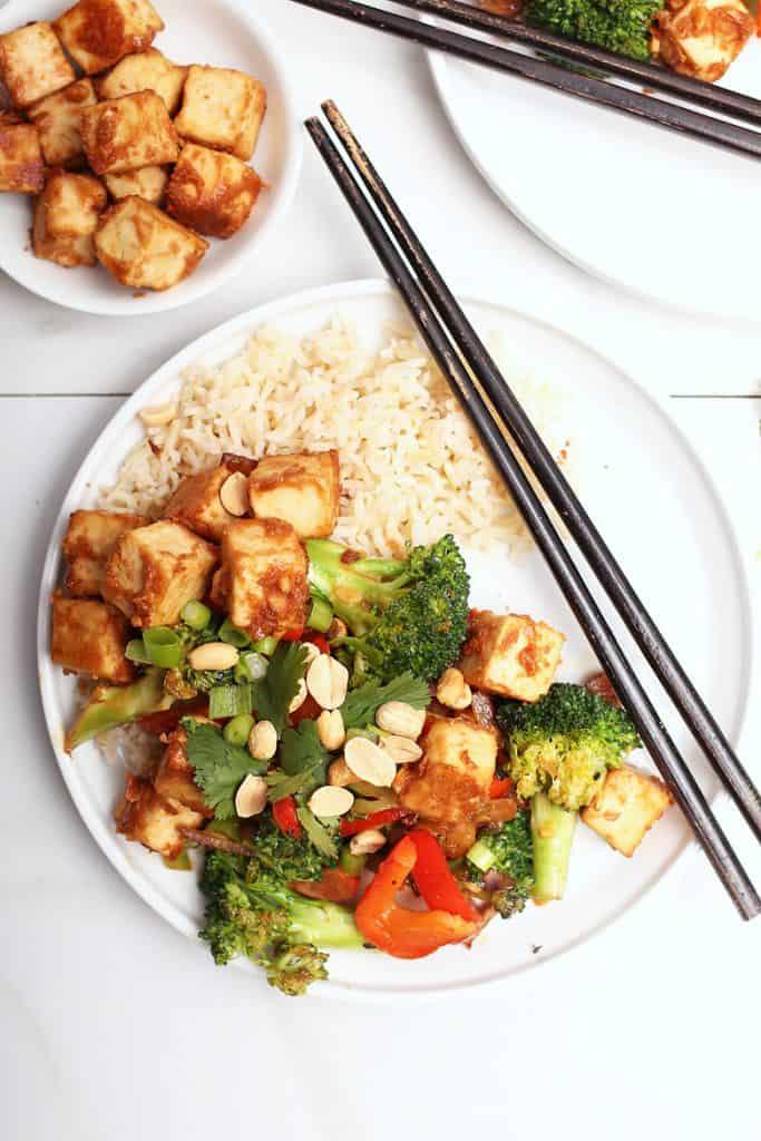 Tofu Stir Fry on white plate with chopsticks