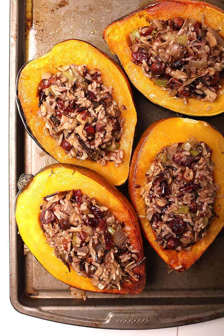 Wild Rice Stuffed Acorn Squash on a baking tray