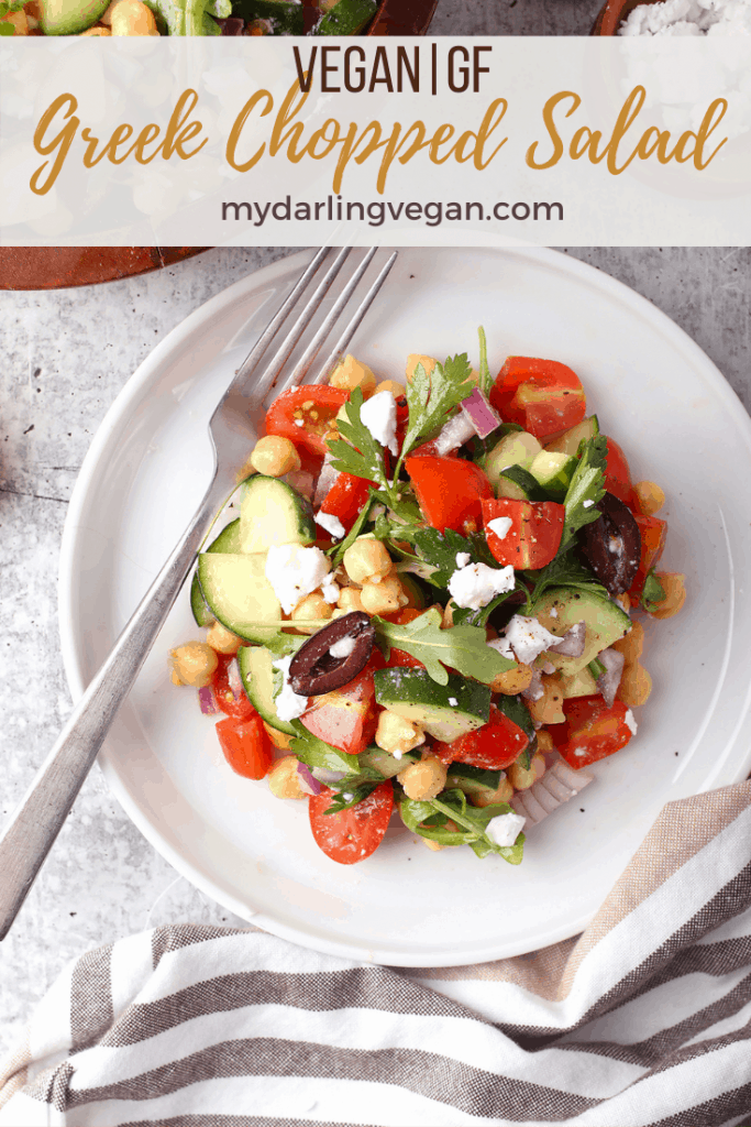 This Greek Chopped Salad is made with chickpeas, tomatoes, cucumbers, and olives all tossed in fresh lemon juice and olive oil for a refreshing vegan and gluten-free light meal or side dish. Made in just 10 minutes!