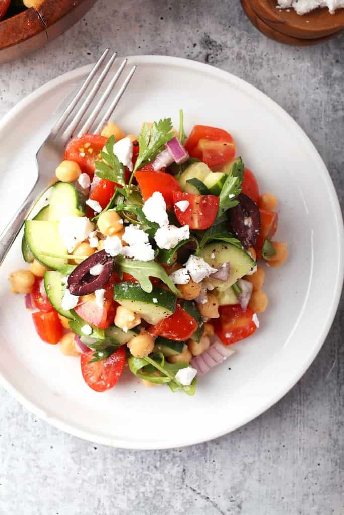 Finished Greek salad on a white plate