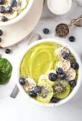 Close up of green smoothie bowl with bananas and blueberries