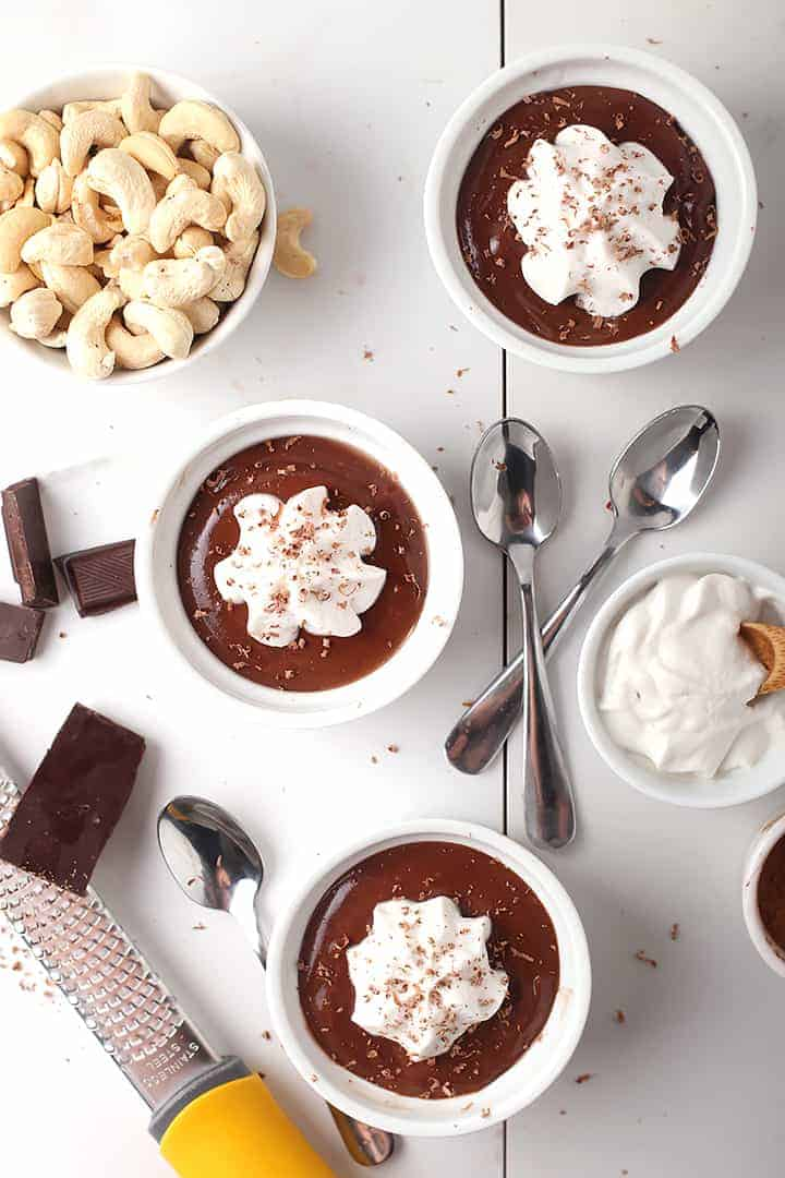 Three vegan pots de creme with whipped cream