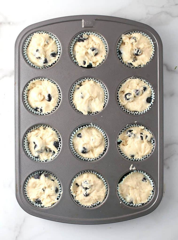 Muffin batter in muffin tin