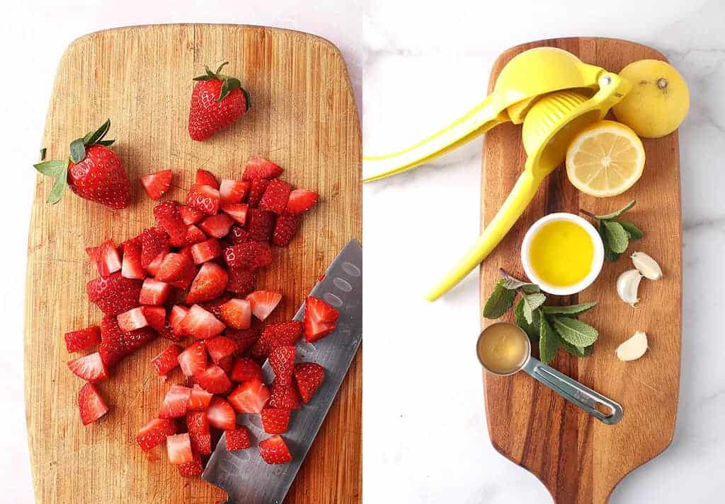 Chopped strawberries and juiced lemons on a cutting board