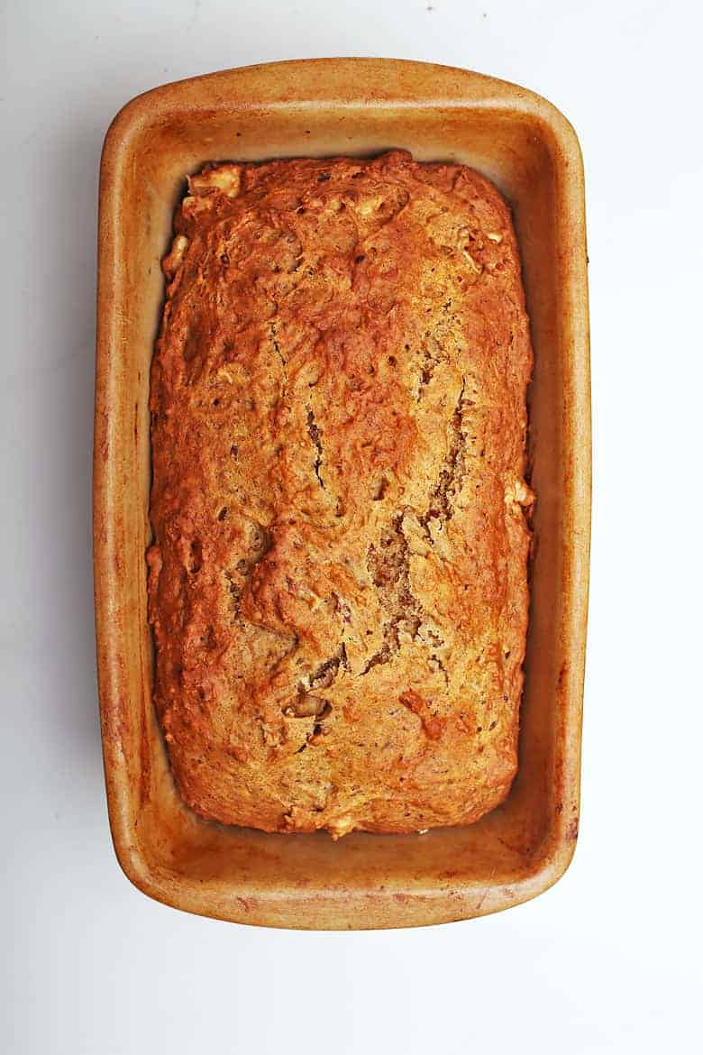 Baked vegan banana bread in a ceramic loaf pan