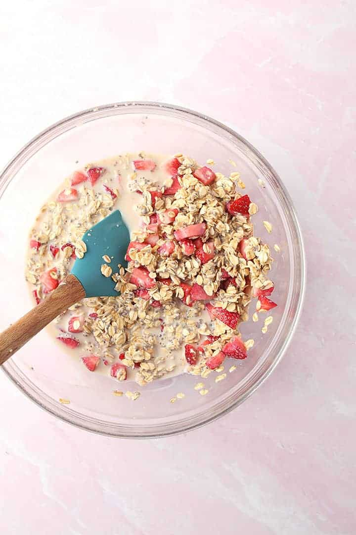 Oats, strawberries, and milk in a bowl