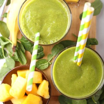 Two Tropical Green Smoothie on a platter