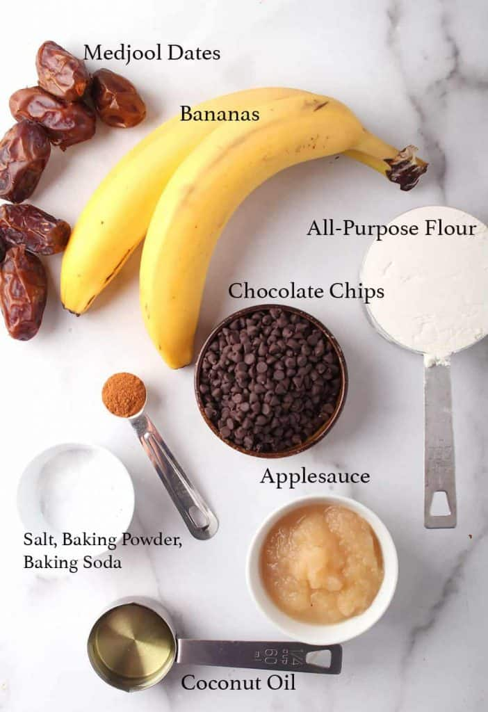Ingredients for banana muffins on a marble top