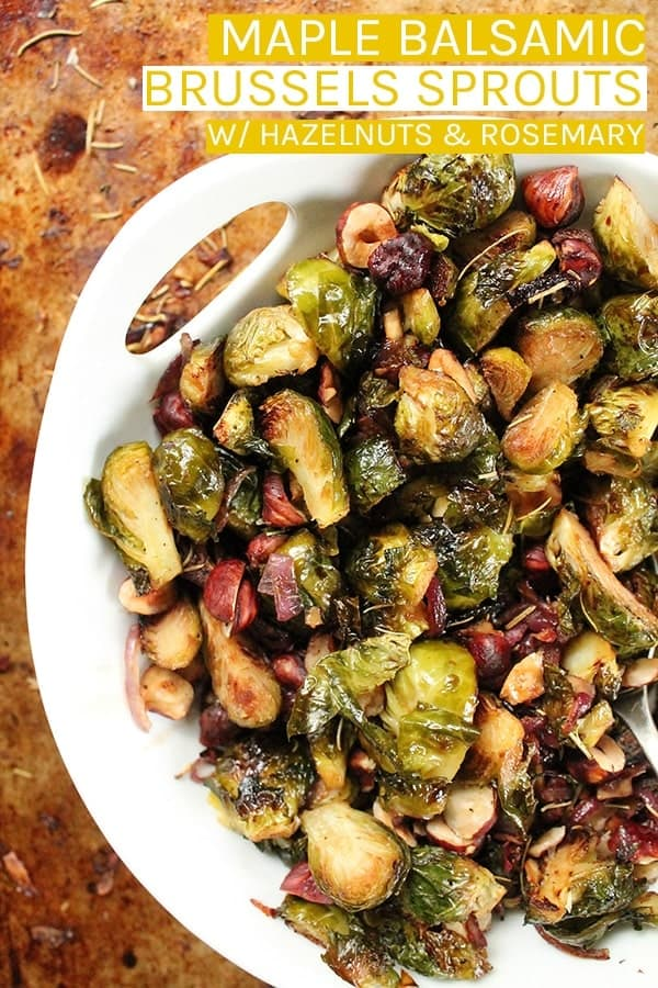 Perfectly tender roasted Maple Balsamic Brussels Sprouts tossed together with roasted hazelnuts and rosemary for the perfect simple and delicious vegetable side dish. #vegan #veganrecipes #brusselssprouts #veganthanksgiving #thanskgivingrecipes #vegetarian
