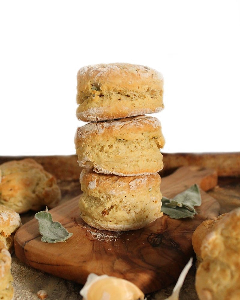 Stack of Sage Garlic Buttermilk Biscuits with a white background.