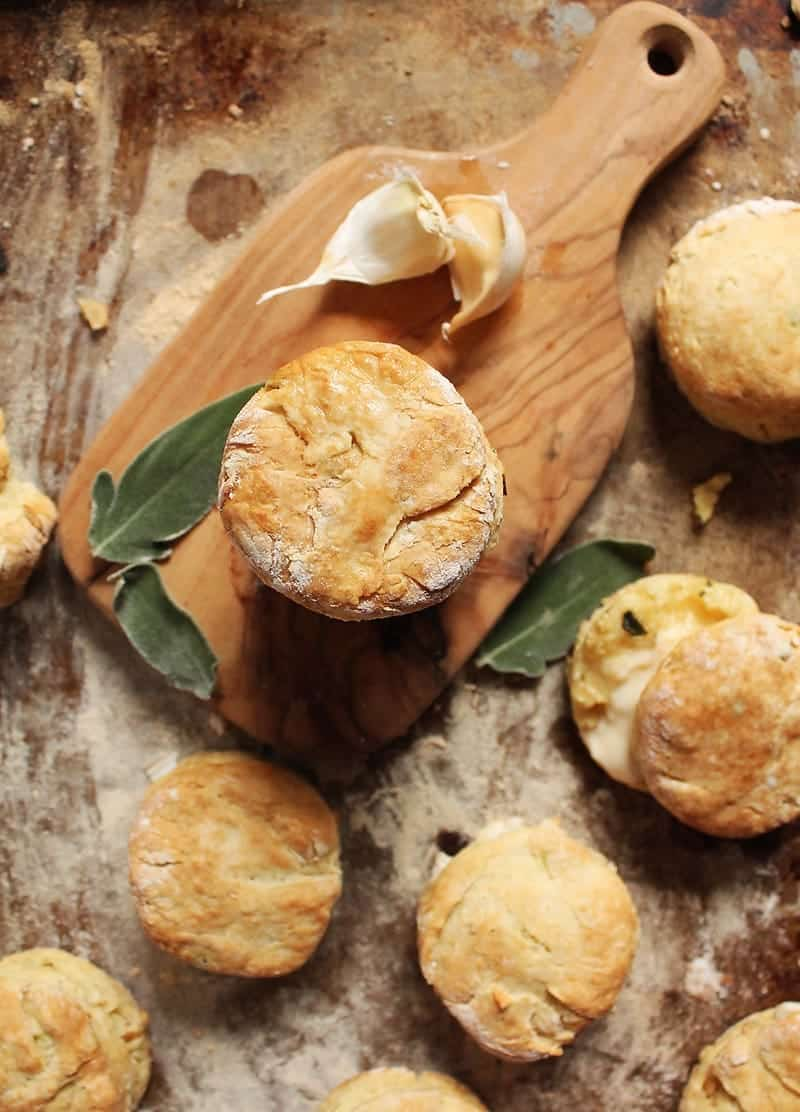 Sage Buttermilk Biscuits on a wooden plate