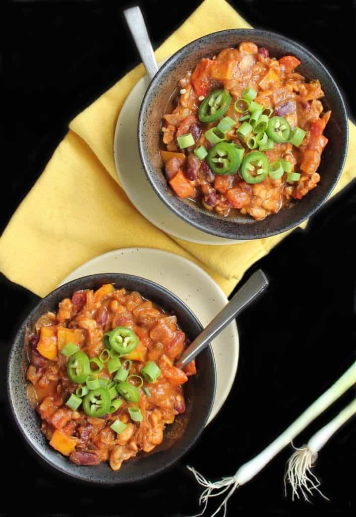 Two bowls of pumpkin tempeh chili