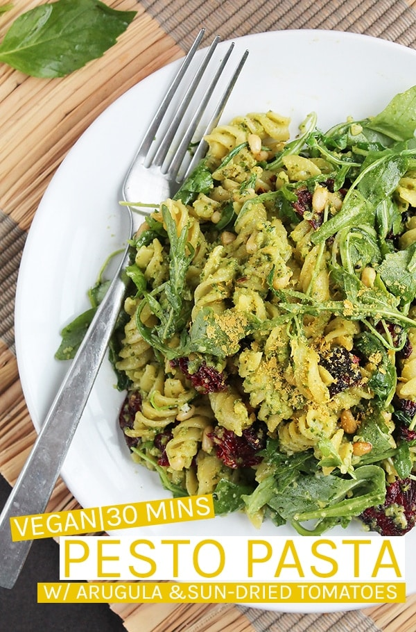 This vegan Pesto Pasta is made with arugula pesto and tossed with sun-dried tomatoes and arugula for a delicious, filling meal the whole family will love. Made in just 30 minutes for an easy weeknight meal. #vegan #veganrecipes #vegandinner #dinner #easydinner #easyrecipes #pasta #pesto #pestopasta