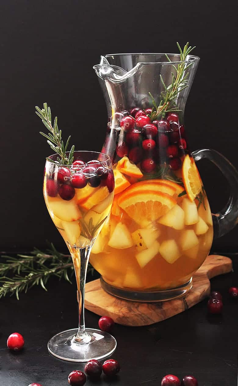 Christmas Sangria in glass pitcher