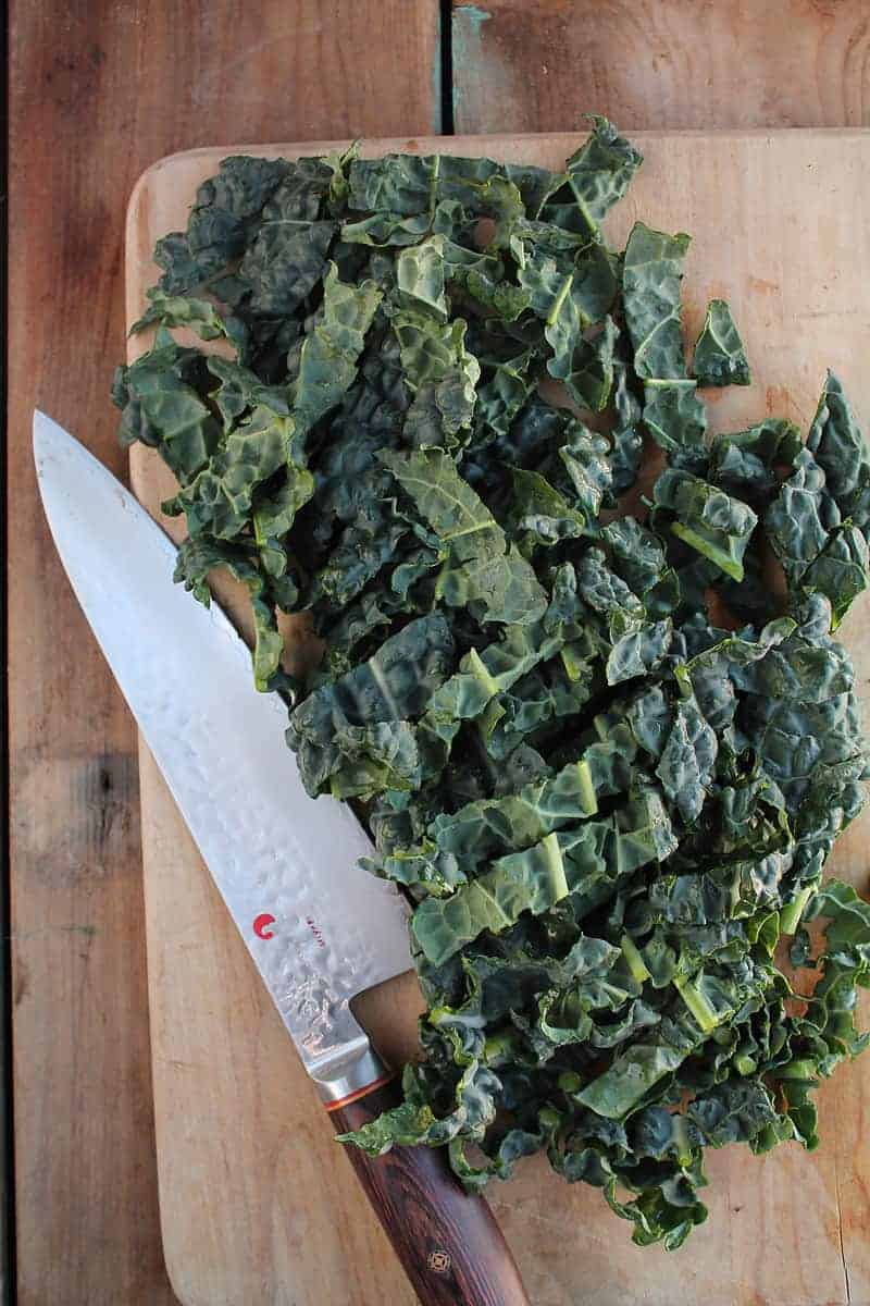 chopped kale on a cutting board