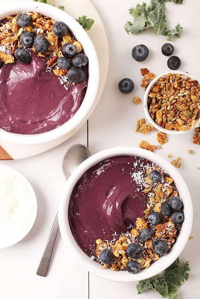 Two vegan blueberry smoothie bowls