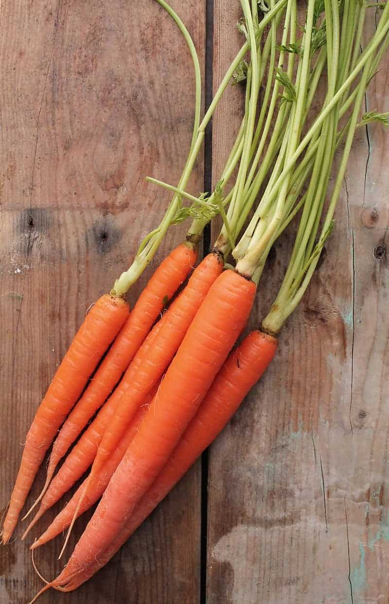 Carrots on wooden backdrop