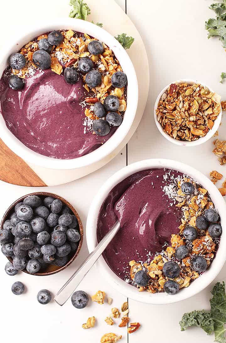 Two vegan blueberry smoothie bowls