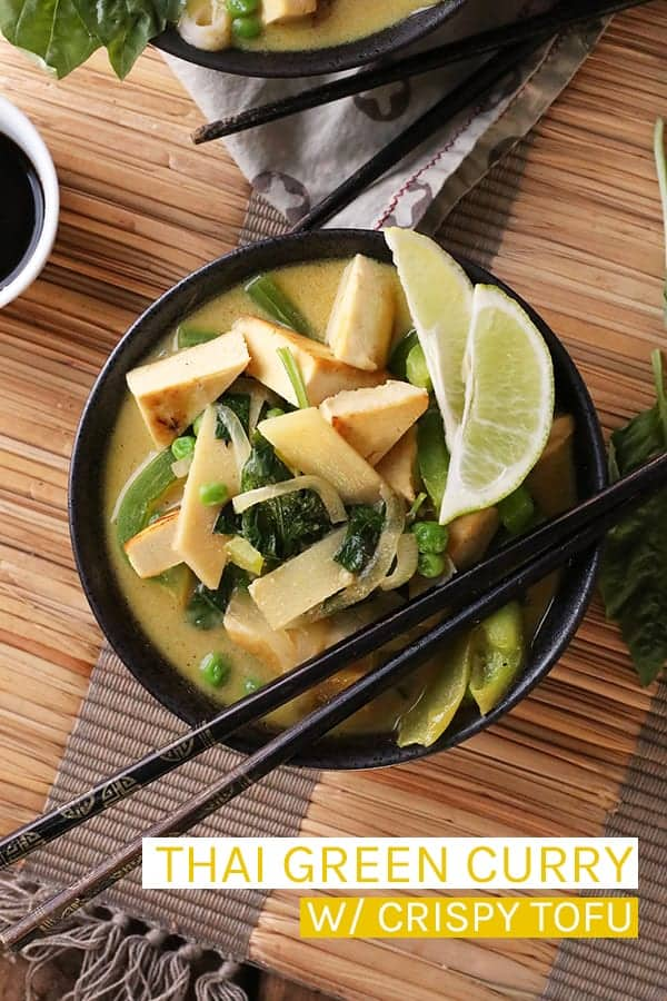 This vegan Thai Green Curry with Tofu is filled with fresh green vegetables and pan-fried tofu for a easy healthy and delicious weeknight meal. #vegan #curry #veganmeals #dinner #dinnerrecipes #easyrecipes