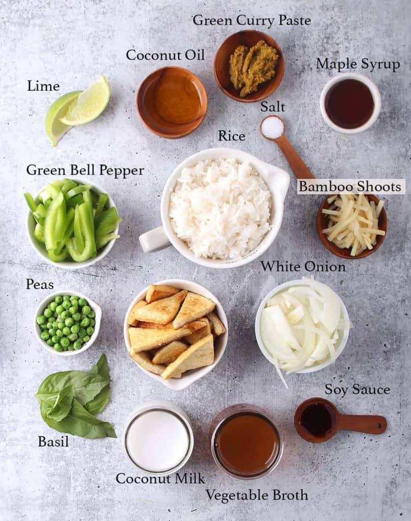 Ingredients for Thai Curry measured out and placed on concrete countertop
