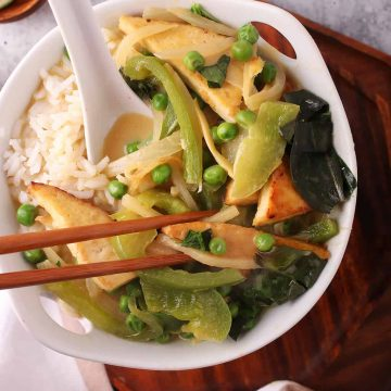 Bowl of Thai Green Curry with chop sticks