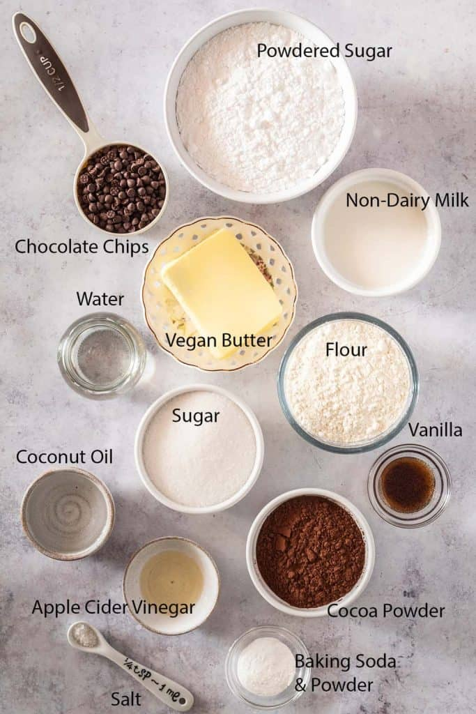 Ingredients for vegan cupcakes measured out and placed on a marble countertop