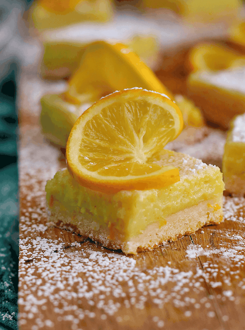 Vegan Lemon Bars with lemon wedge