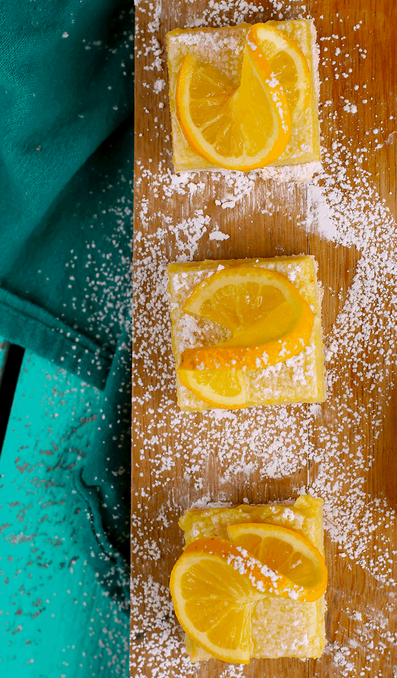 Vegan Lemon Bars on wooden platter