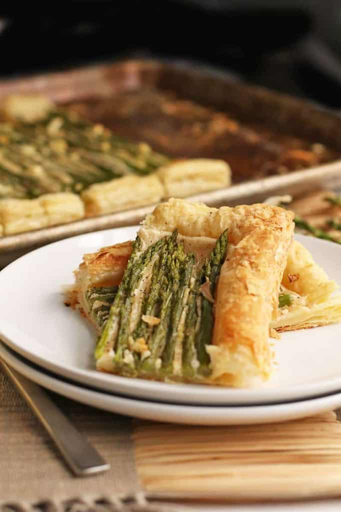Finished asparagus tart on a white plate