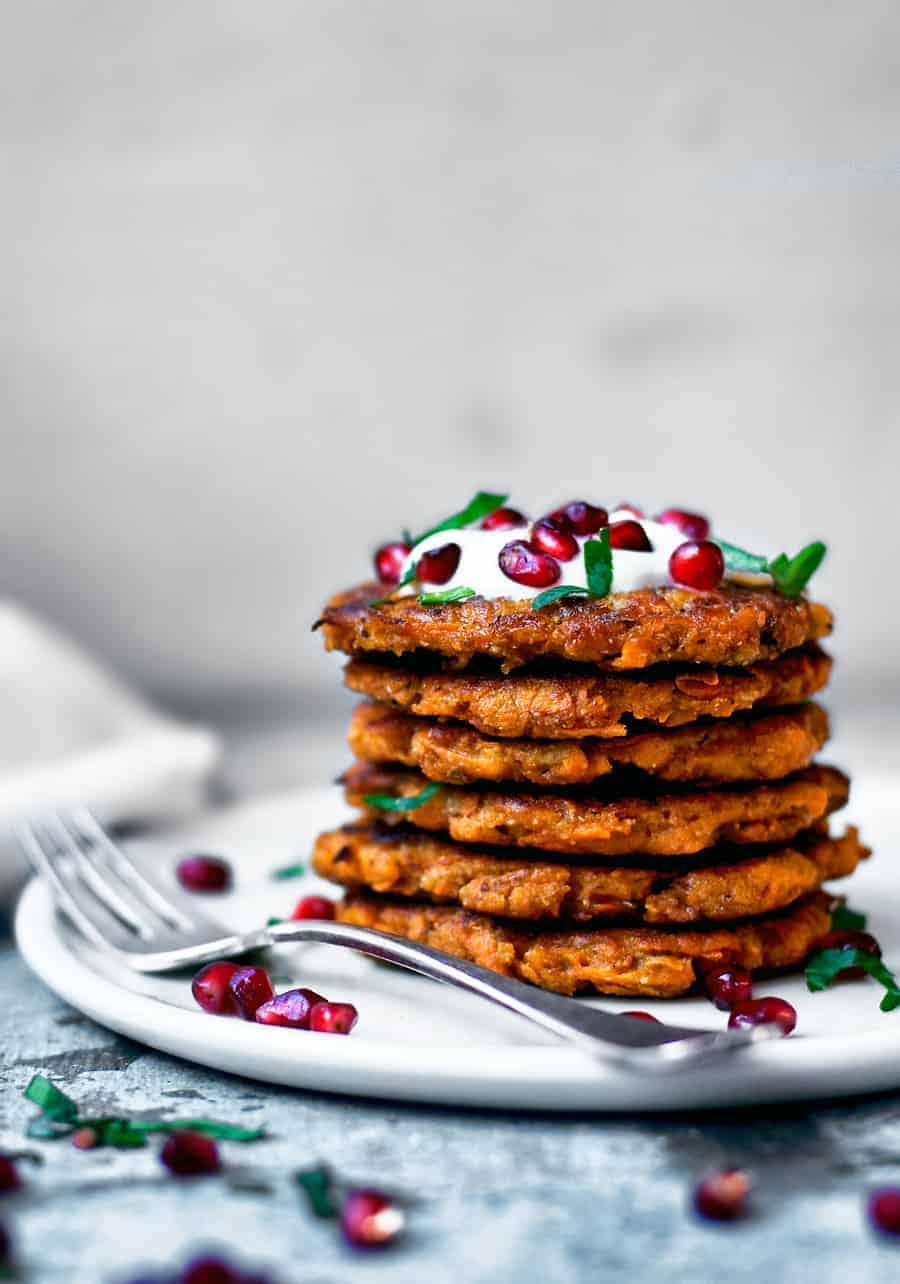 Stack of Spicy Sweet Potato Pancake with pomegranate.