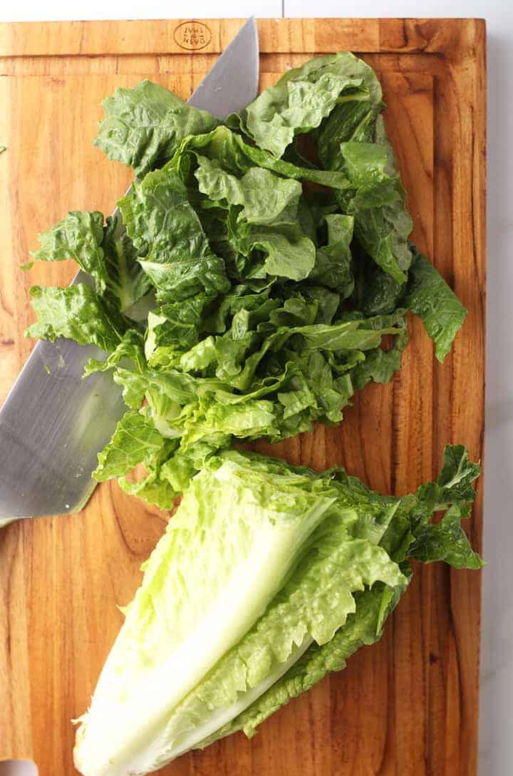 Chopped Romaine lettuce on cutting board
